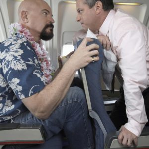 Men facing off about tight space on an airplane