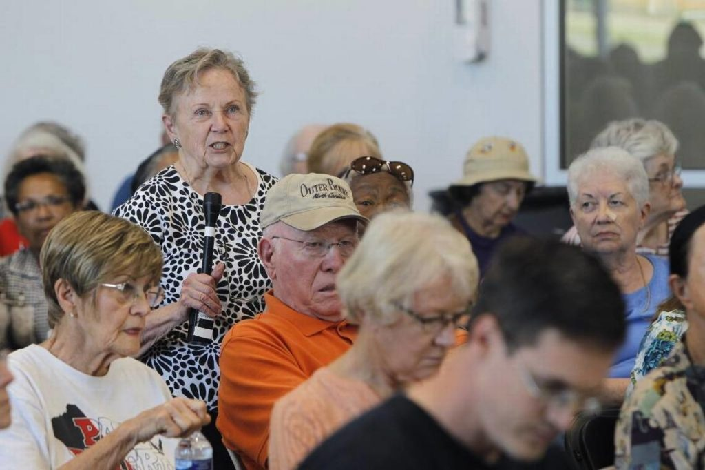 Senior citizens at a town hall meeting