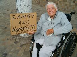 Elderly woman holding sign saying she is homeless