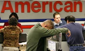 exasperated man at American Airlines Counter