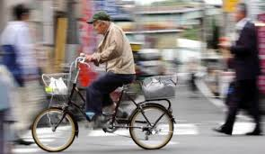 Senior Citizen Riding a Bike