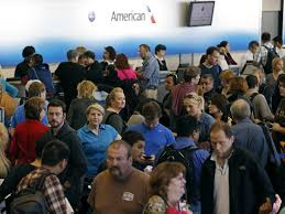 crowds at American Airlines ticket counter